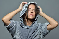Portrait of the beautiful woman in grey hoody blouse.