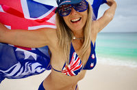 Fun loving woman waving proudly the Australian Flag