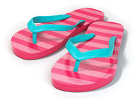 Pink flip flops isolated on white background.