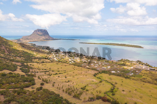 Aerial view of La Gaulette, popular kitesurfing tourist town with Le Morne Brabant mountain, the World Heritage UNESCO site seen in the back.