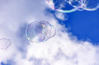 Soap bubbles with clouds