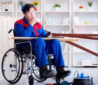 Disabled carpenter working in workshop