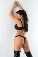Brunette in black lingerie rearview