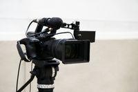 digital video or movie camera on tripod