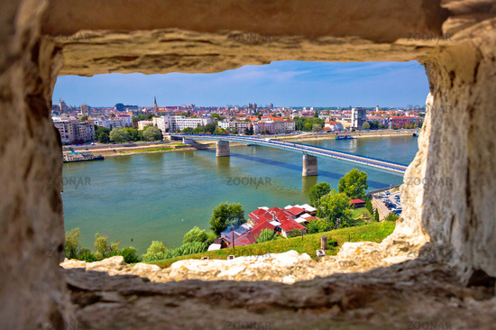 City Of Novi Sad and Danube river aerial view through stone window from Petrovaradin