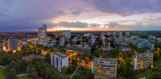 Munich from above, a panoramic droneshot in the colorful evening with office bulidings in a working discrict.