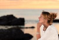 Beautiful woman enjoying the sunset