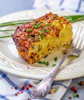 Piece of potato kugel on a plate.