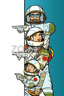 Family astronauts mom dad and son. Point to copy space poster