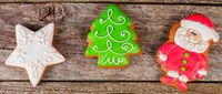 Gingerbread winter Christmas tree on wooden