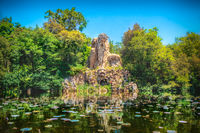 Villa Demidoff Pratolino park and the Colosso del Appennino colossus statue with pond full of waterlilies and leaves