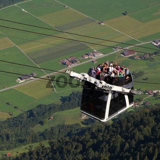 The first cable car of the world with a roofless upper deck. Stanserhorn cable car, Switzerland.