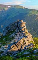Big boulder on summer mountain slope