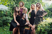 Six girls posing on camera