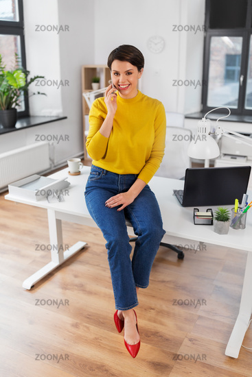 happy woman and calling on smartphone at office