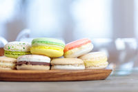 Close-up of colorful macaron (macaroon) on the table with hot tea