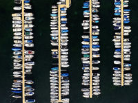 Bird's eye view on boats moored at berths in a yacht harbour at the Lake Geneva, Rolle,Switzerland