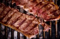 delicious grilled meat on barbecue