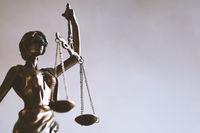 lady justice or justitia figurine - law and jurisprudence symbol