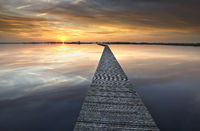 long walkway on big lake at sunset