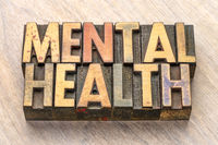 mental health word abstract in wood type