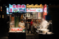 Food stall operating at night