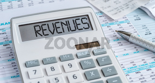 A calculator with the word Revenues on the display