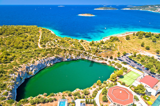 Rogoznica turquoise coastline and Dragon Eye lake aerial view