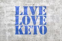 Live, love keto -  graffiti on stucco wall