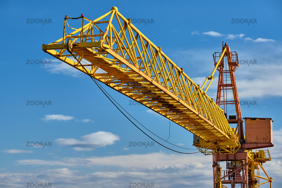 Jib crane tower against blue sky