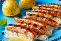 Nürnberger  bratwurst with sauerkraut and dumplings
