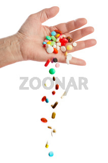 Hand and falling pills