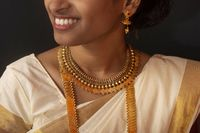Young girl in traditional Kerala saree and jewelry.