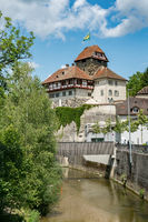 view of the historic half-timbered medieval castle and Murg river in the city of Frauenfeld