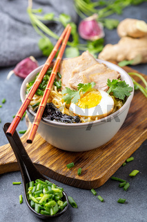 Soup with noodles, pork and egg in Asian style.