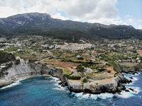Breathtaking scenery landscape waterside aerial photo of Banyalbufar village distant view, Palma de Mallorca, Balearic Islands, Spain