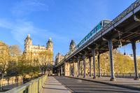 Paris France city skyline sunrise at Seine River and Pont de Bir-Hakeim bridge with Paris Metro