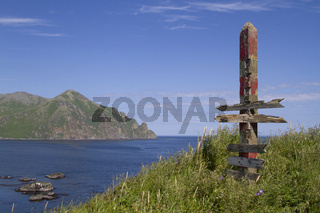 old distance indicator standing on the hill near the abandoned village on the Medny Island