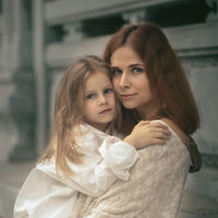 Beautiful portrait of a mother holding daughter