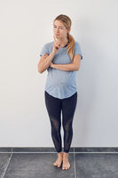 Attractive young barefoot pregnant woman