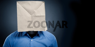 Businessman wearing a paper bag