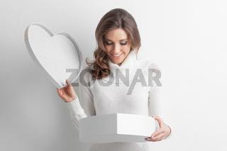 Girl open heart shaped box