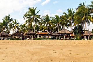 Deckchairs and parasol tropical beach sea landscape, romantic pa