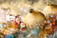 Golden Christmas bauble and Santa Claus