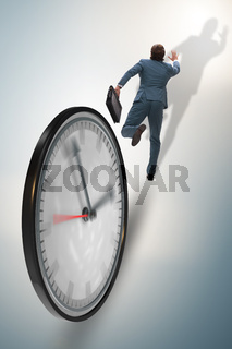 Businessman employee in time management concept