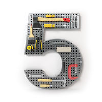 Number 5 five. Alphabet from the tools on the metal pegboard isolated on white.