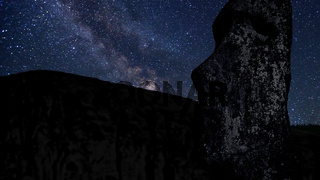 time lapse with stars, foreground statue Moai in the Rano Raraku volcano Easter Island, Chile