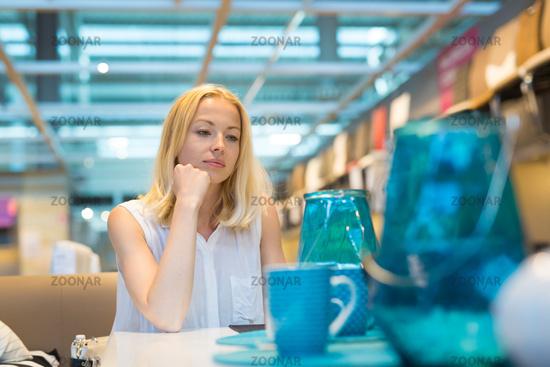 Beautiful young woman shopping in retail store.