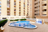 Typical high rise house with common swimming pool, Torrevieja, Spain