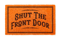 Shut The Front Door Halloween Orange Welcome Mat Isolated on White Background